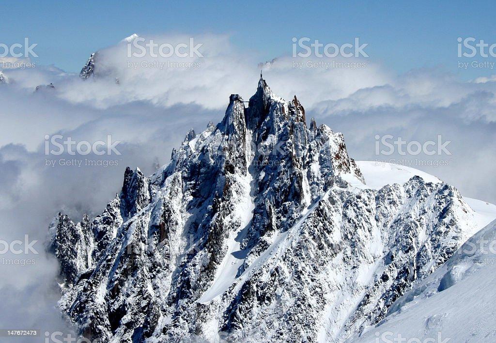 Aguilar de Midi high snow covered spiky mountain peak stock photo