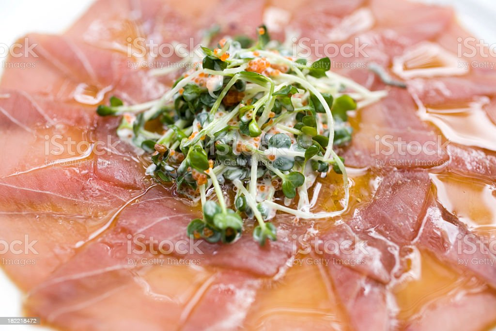 ahi tuna carpaccio isolated on white royalty-free stock photo