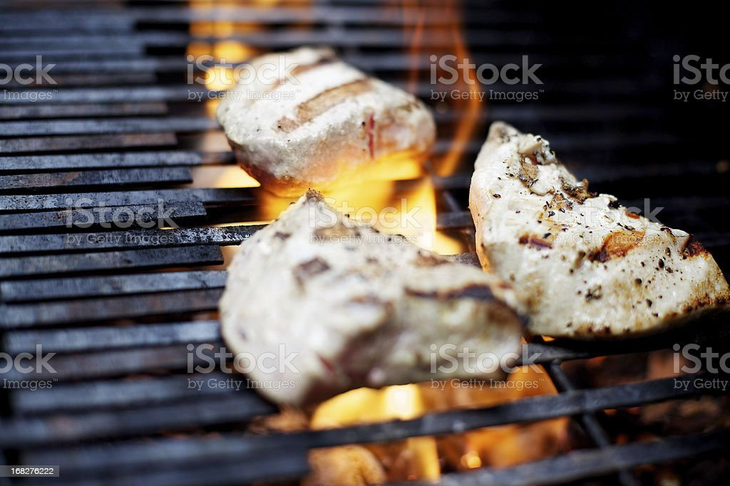 Ahi Tuna on flaming outdoor bbq grill royalty-free stock photo