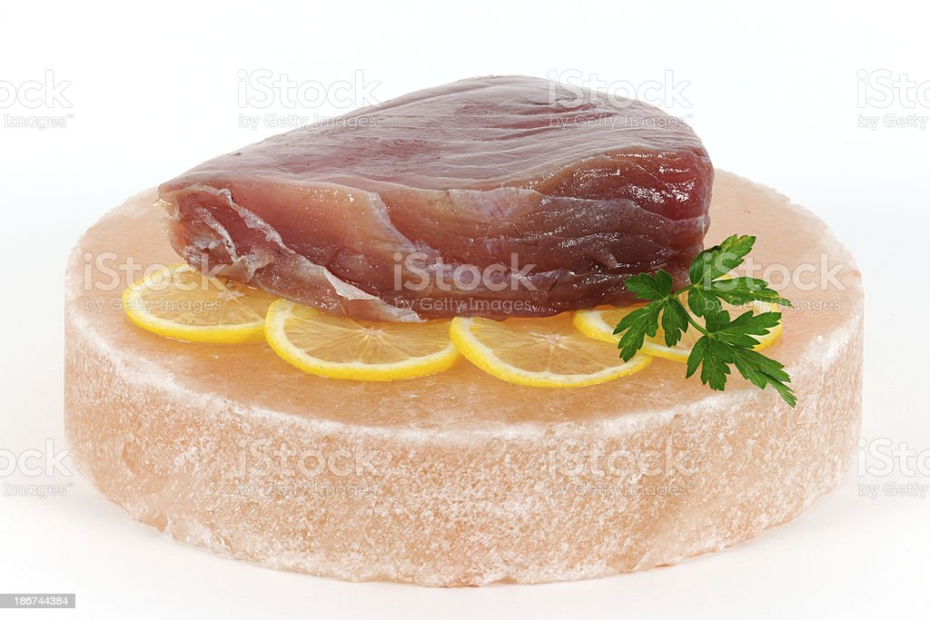 Ahi Tuna Steak on Himalayan Salt Block royalty-free stock photo