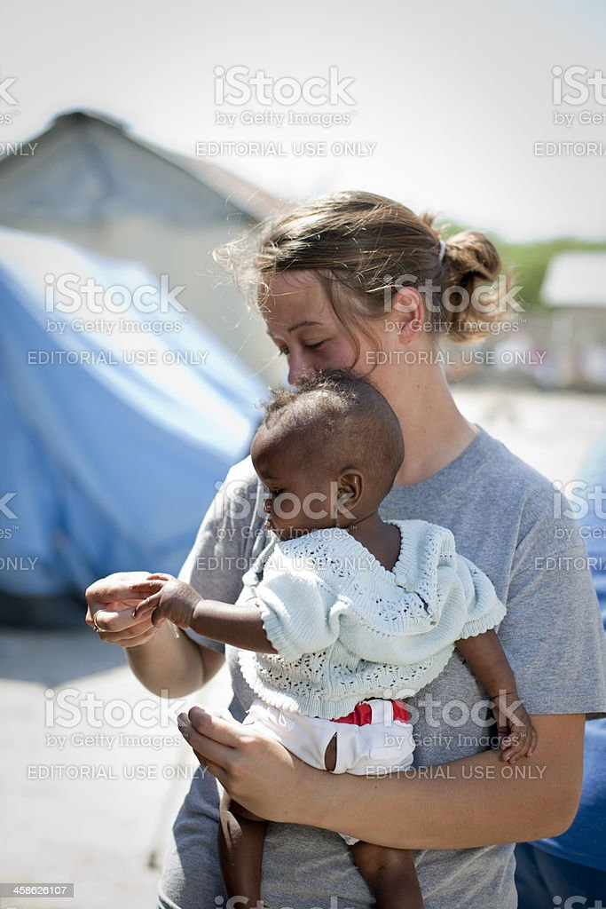 Aid worker with baby stock photo