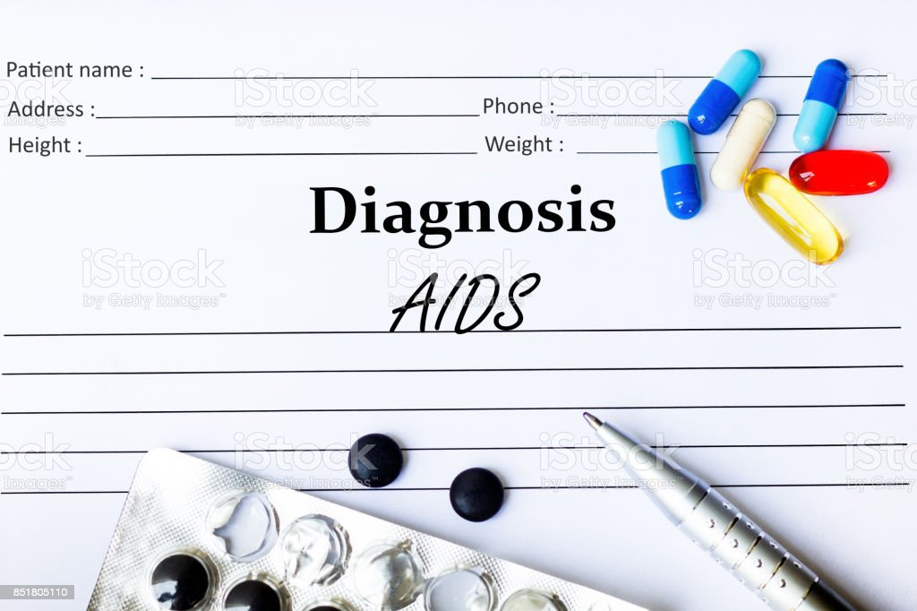 Aids - Diagnosis written on a piece of white paper with medication and Pills stock photo