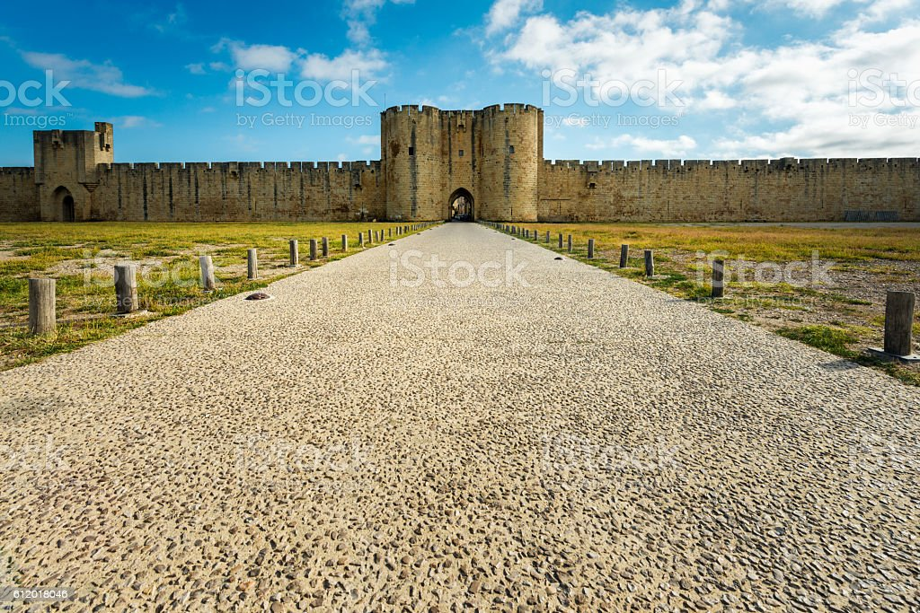 Aigues-Mortes entrance in city wall stock photo
