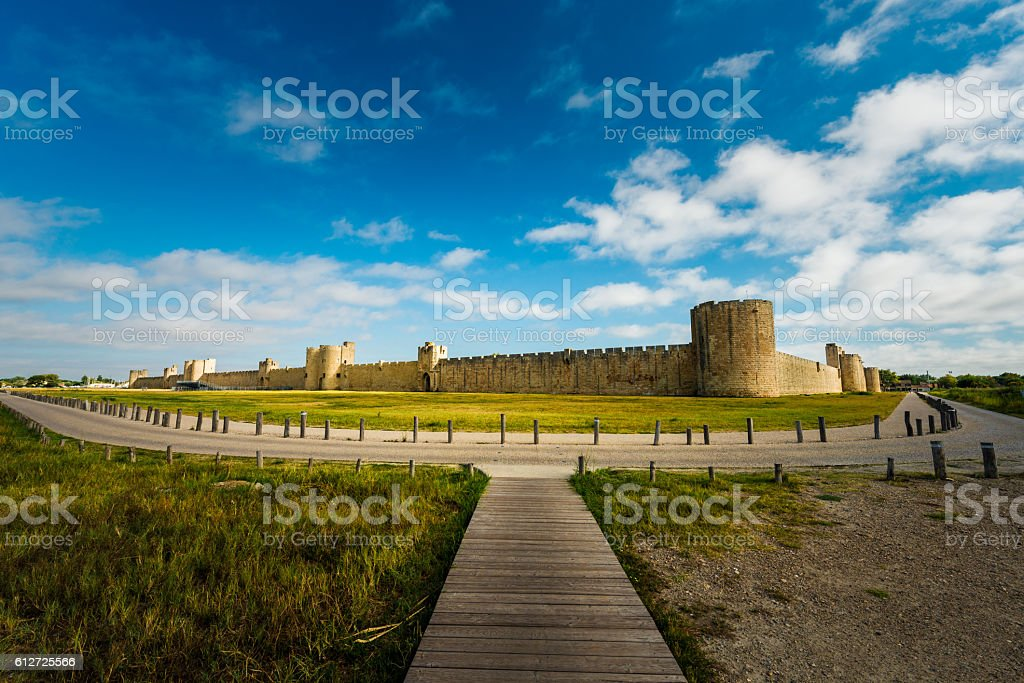 Aigues-Mortes wooden path to city wall stock photo