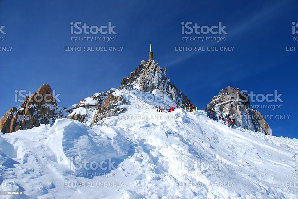 aiguille du midi, with skiers coming down stock photo