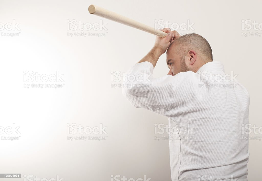 Aikido man with a stick royalty-free stock photo