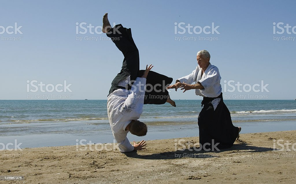 aikido on the beach stock photo