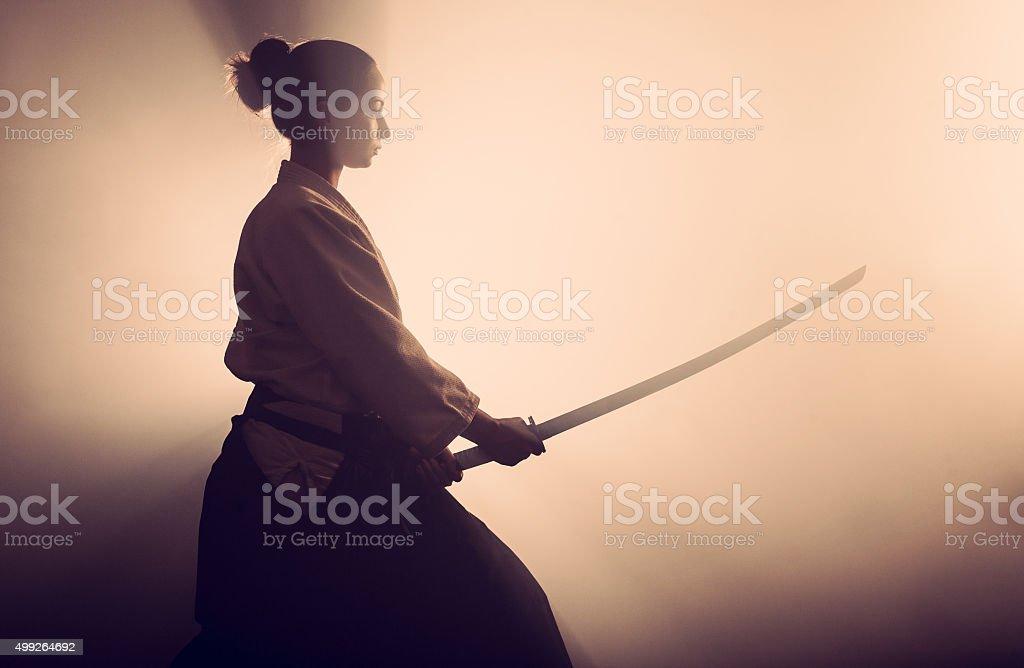 Aikido woman with samurai sword stock photo