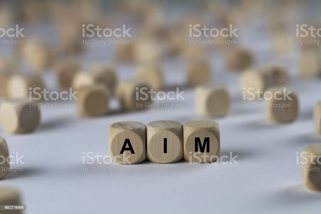 aim - cube with letters, sign with wooden cubes stock photo