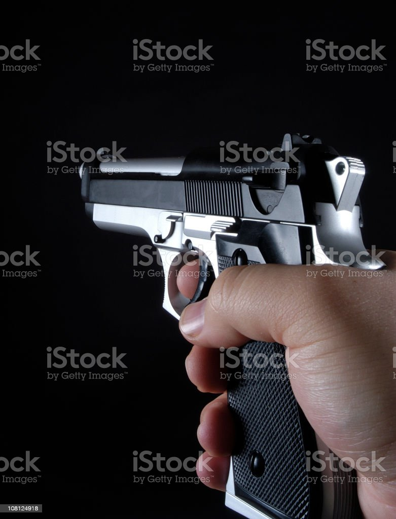 aiming 9mm handgun royalty-free stock photo