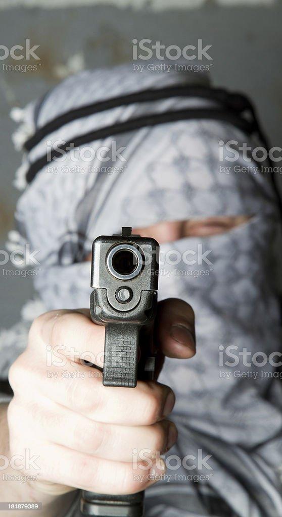 Aiming a gun at you stock photo