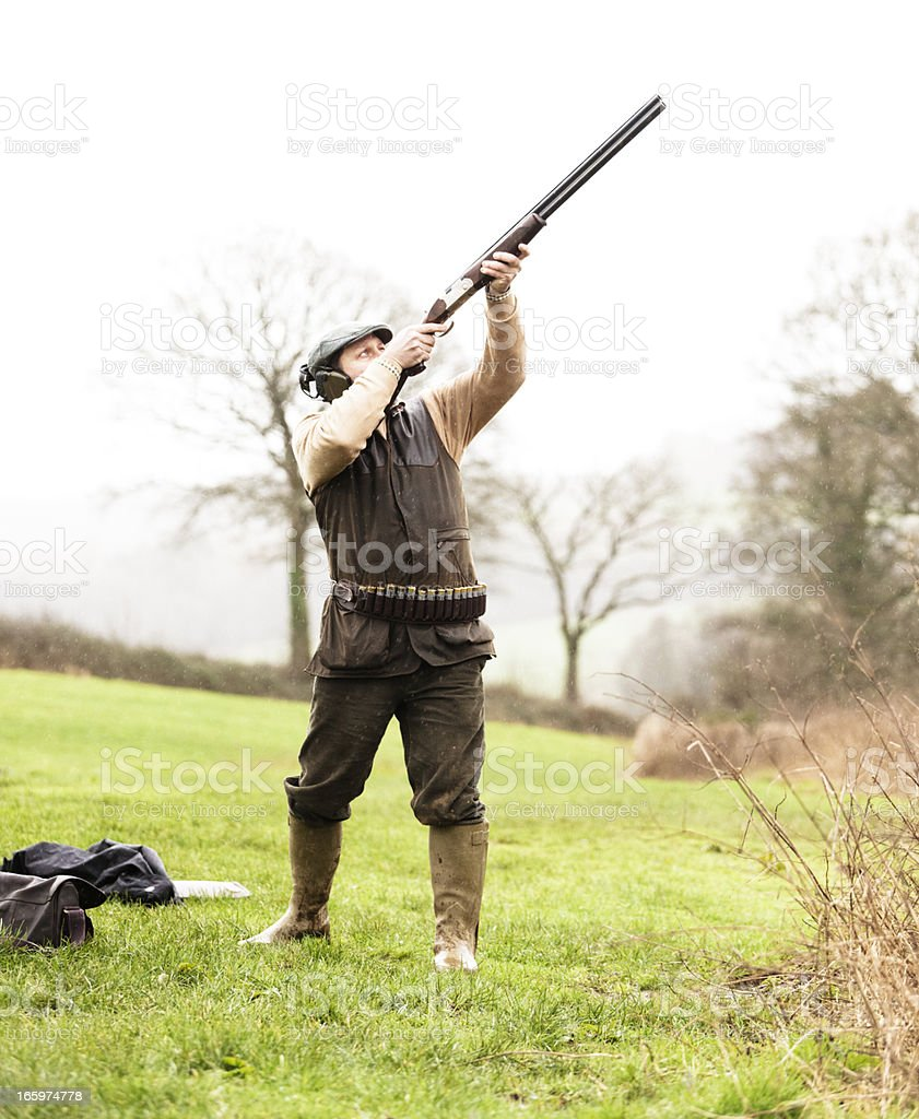 Aiming at a gamebird royalty-free stock photo