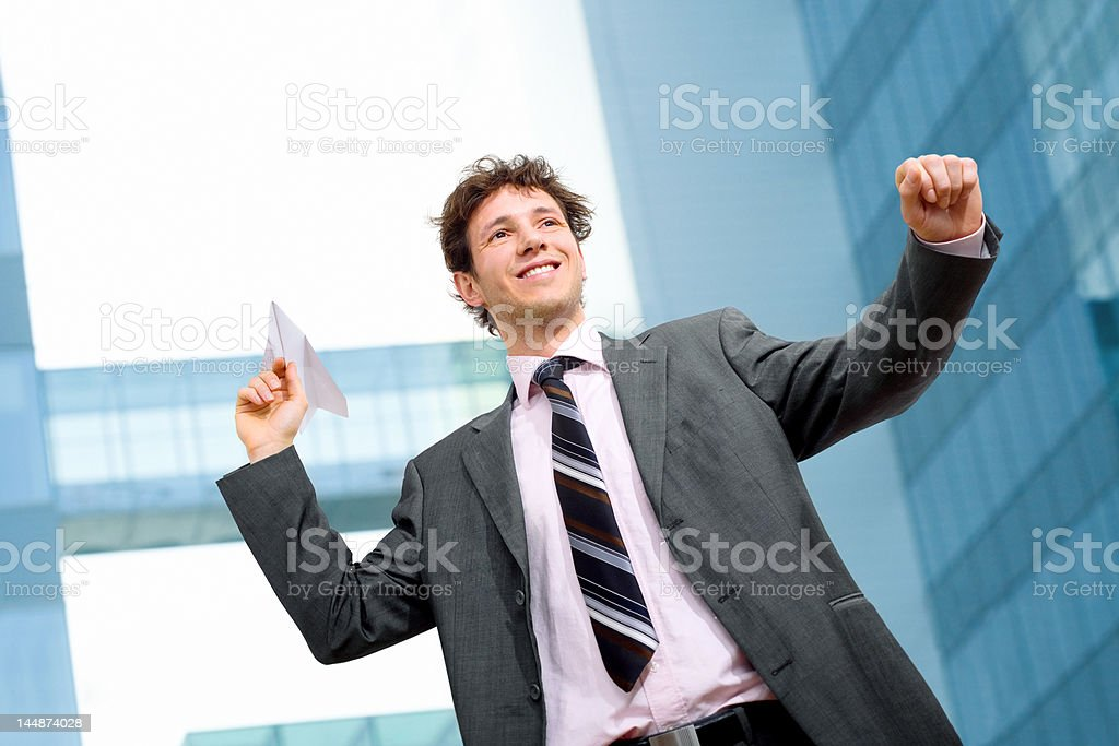 Aiming paper airplane royalty-free stock photo