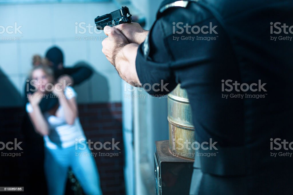 Aiming to the criminal stock photo