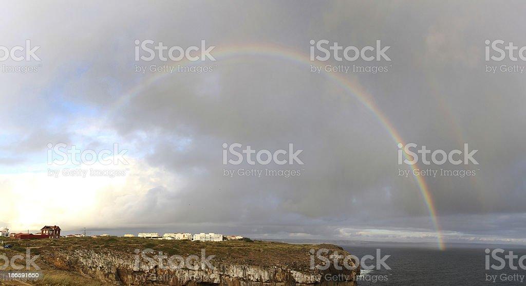 ainbow over shore stock photo