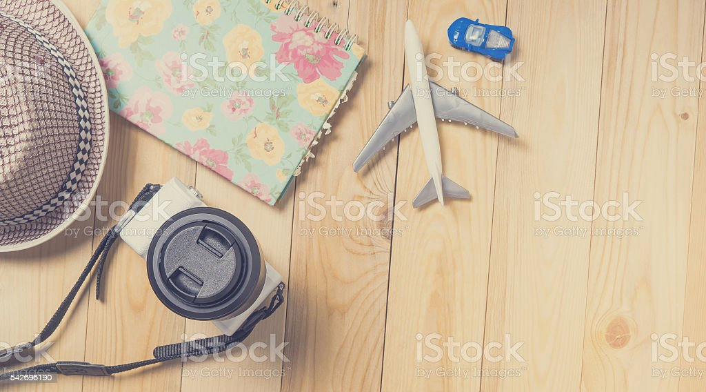Air and land Traveller equipments flat lay on wooden Banner. stock photo