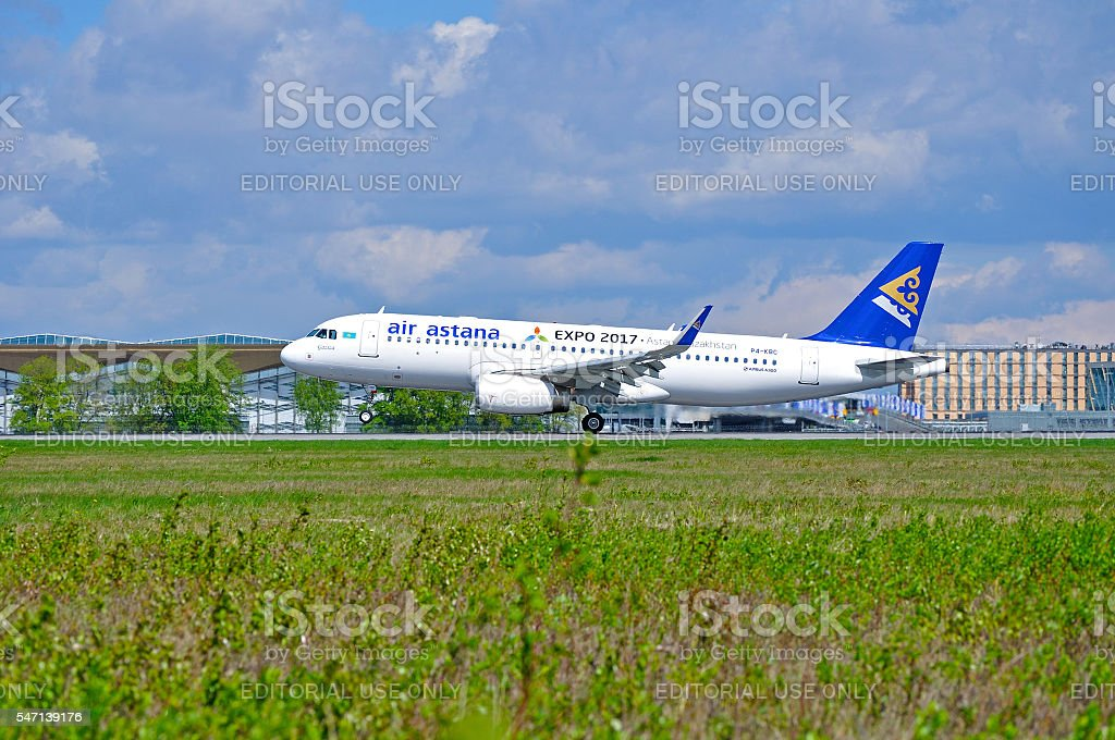 Air Astana Airbus A320 aircraft is riding on the runway stock photo
