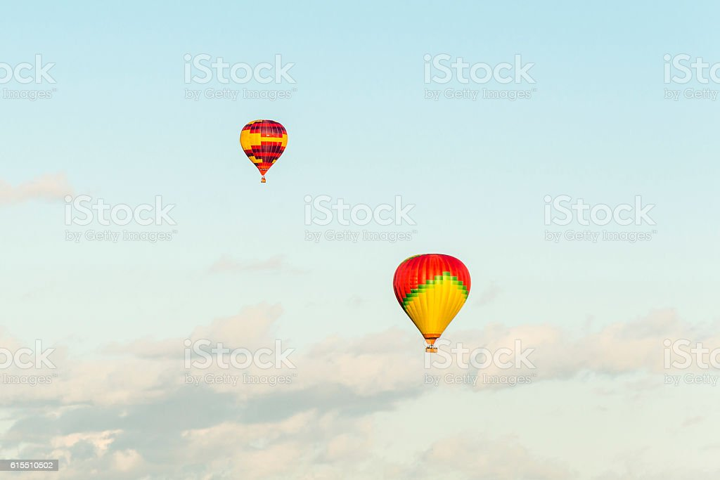 Air balloons above the clouds stock photo