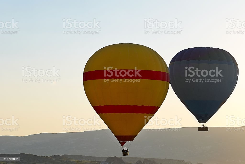 Air balloons in morning sky stock photo