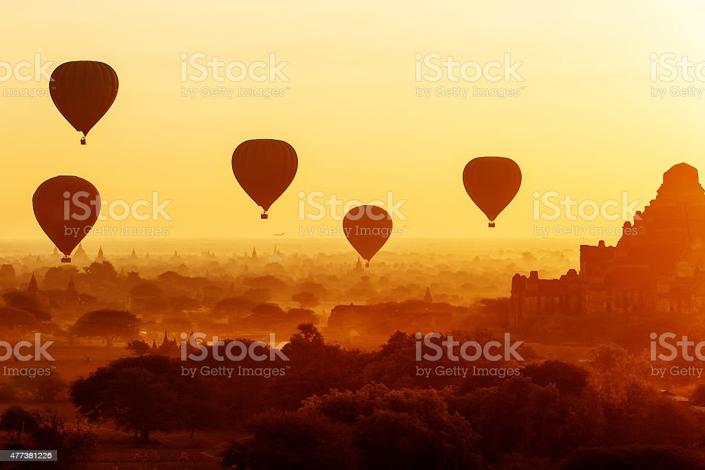 air balloons over Buddhist temples at sunrise. Bagan, Myanmar. stock photo