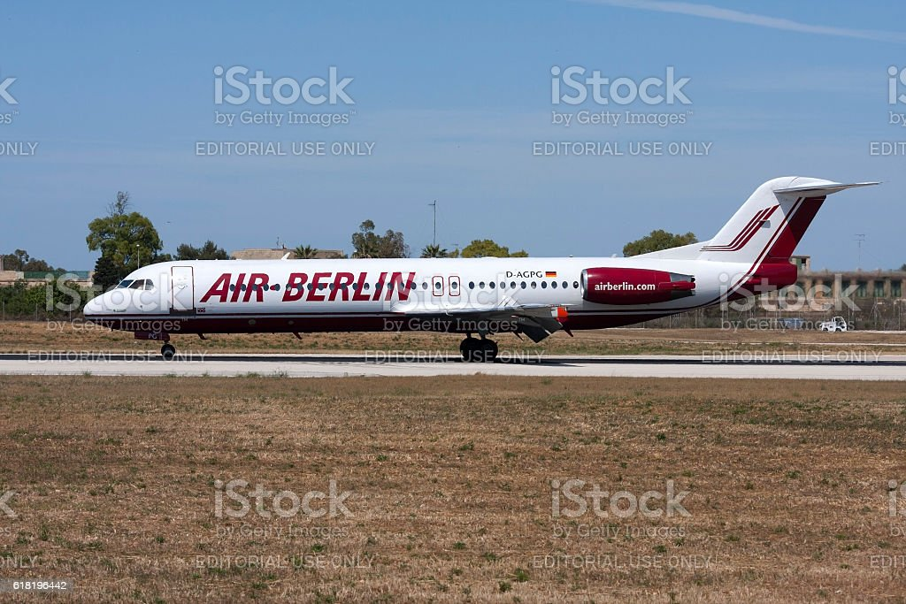 Air Berlin Fokker 100 braking after touch down stock photo