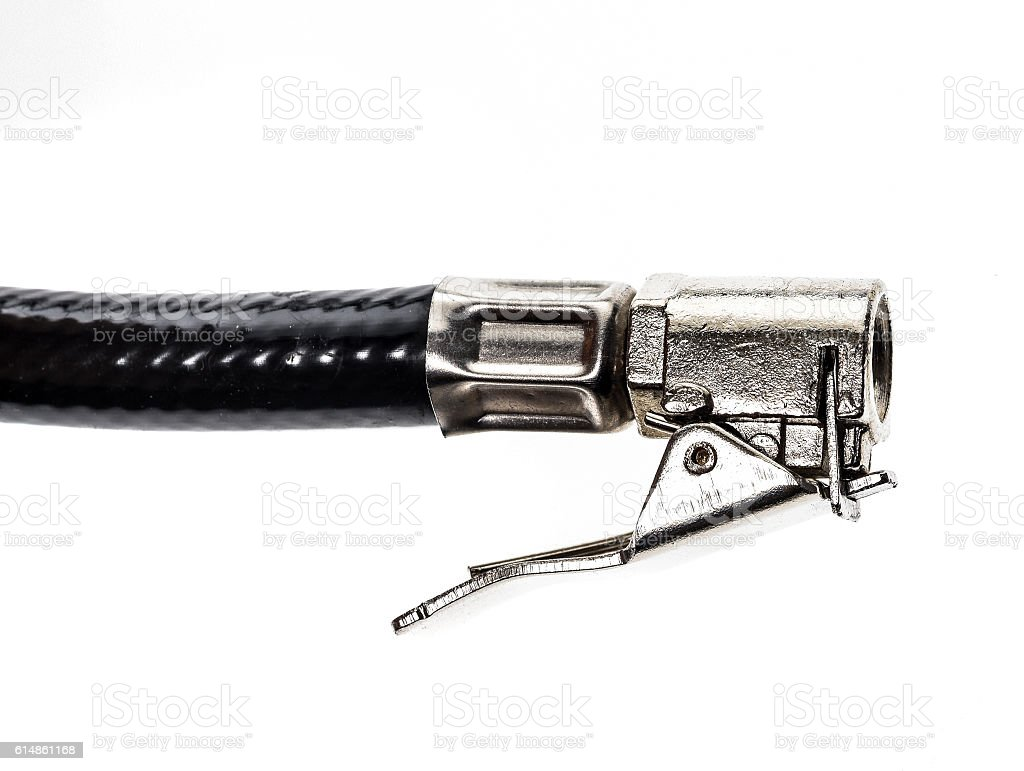Air compressor gun accessory mount for inflating car tire. stock photo