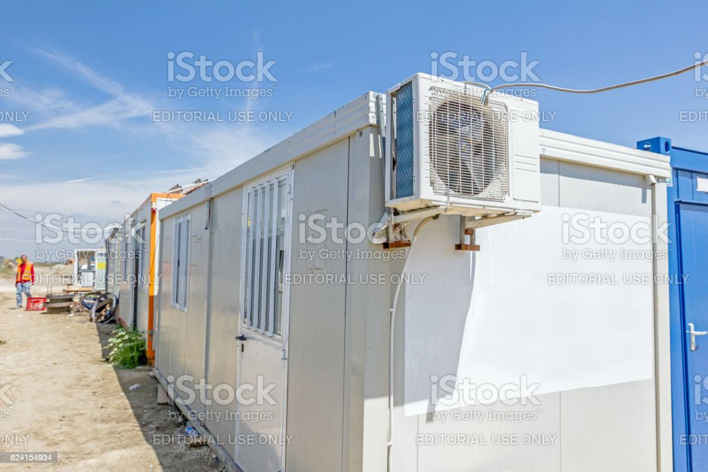 Air compressor is set on the outside wall of container office stock photo