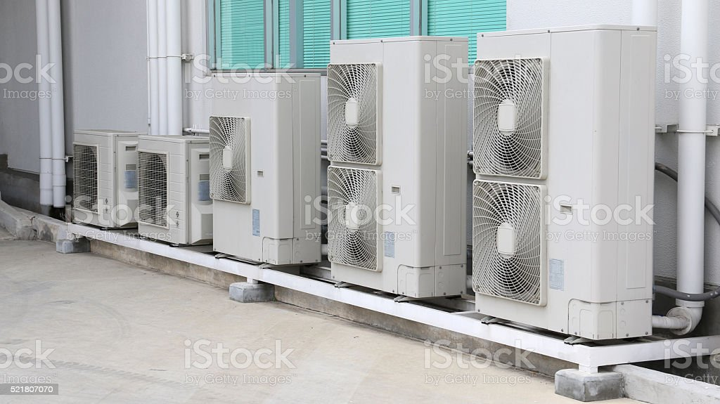 Air compressor on roof of factory. stock photo