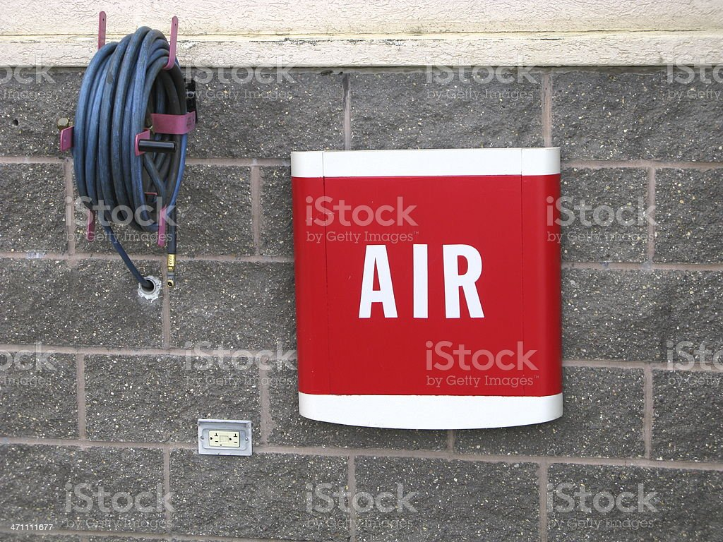 Air Compressor Pump Vintage Hose Gas Station royalty-free stock photo