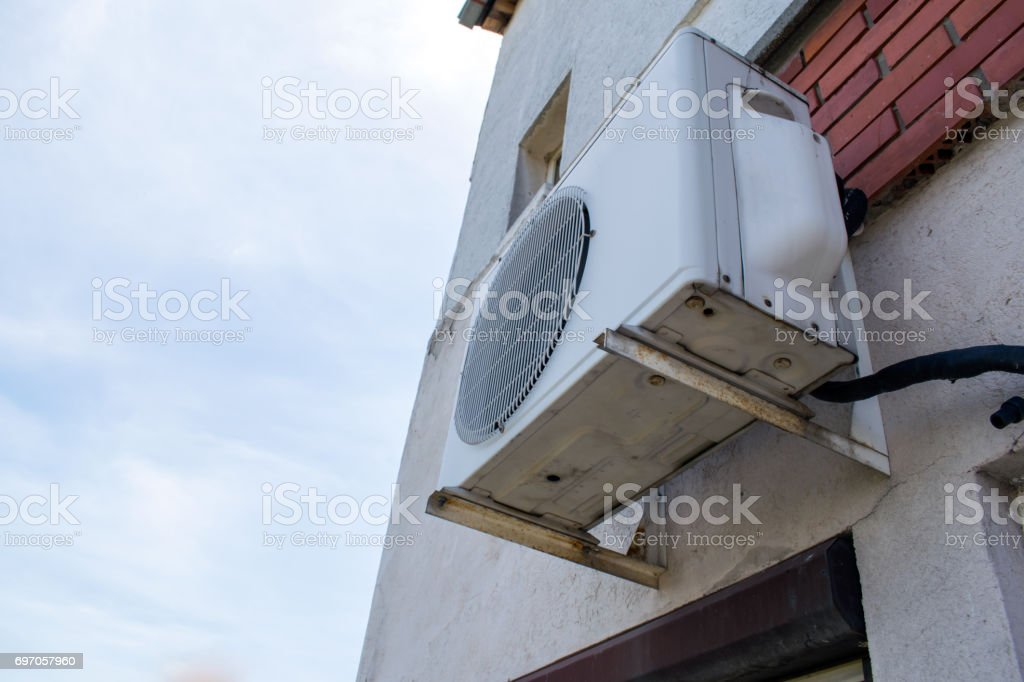 air conditioner, air compressor on the brick wall