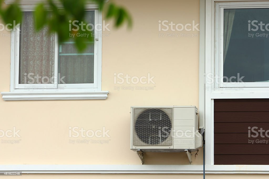 Air Conditioner at the wall stock photo