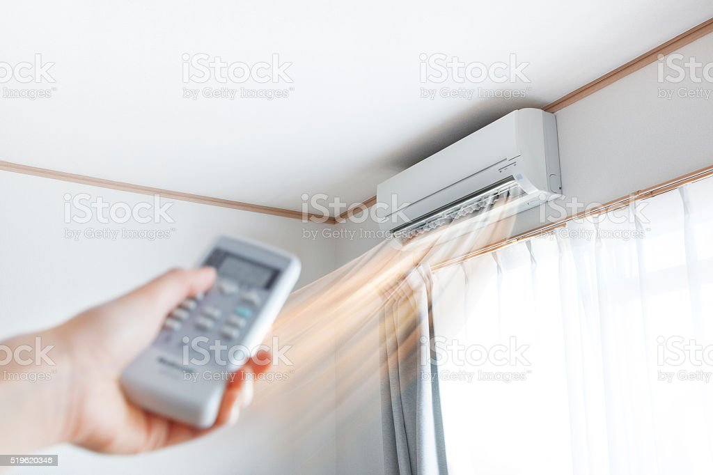 Air conditioner blowing warm air stock photo