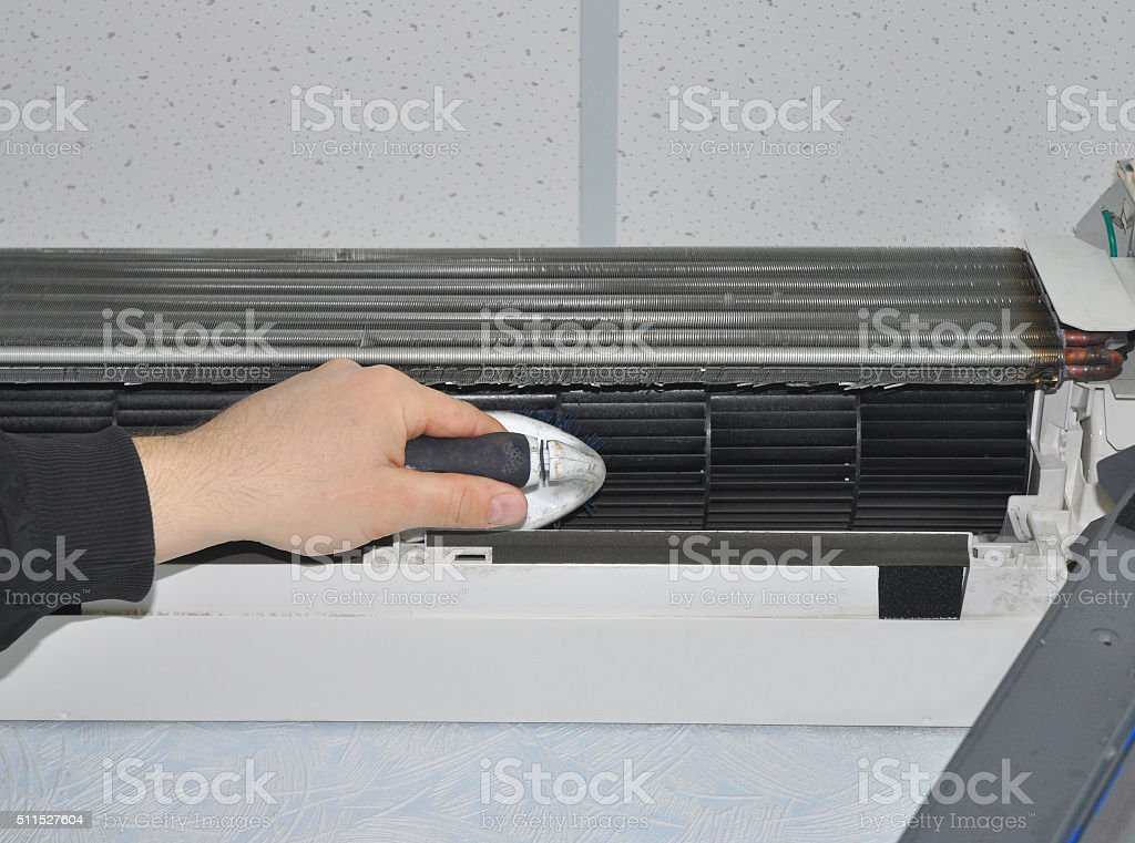 Air Conditioner Cleaning with Brush stock photo