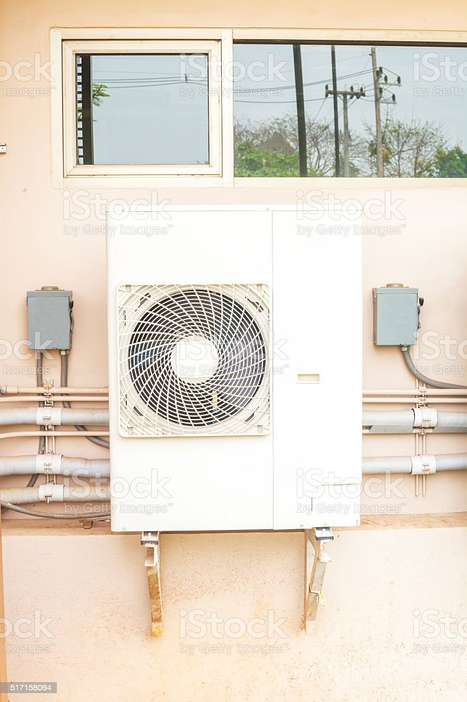 air conditioner compressor units or Refrigeration plant at outdoors building stock photo