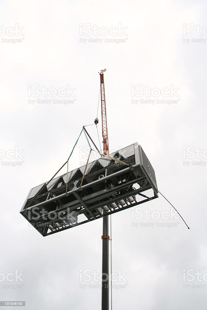 Air Conditioner hoisted by crane stock photo