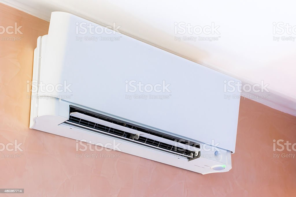 air conditioner installed on the wall stock photo