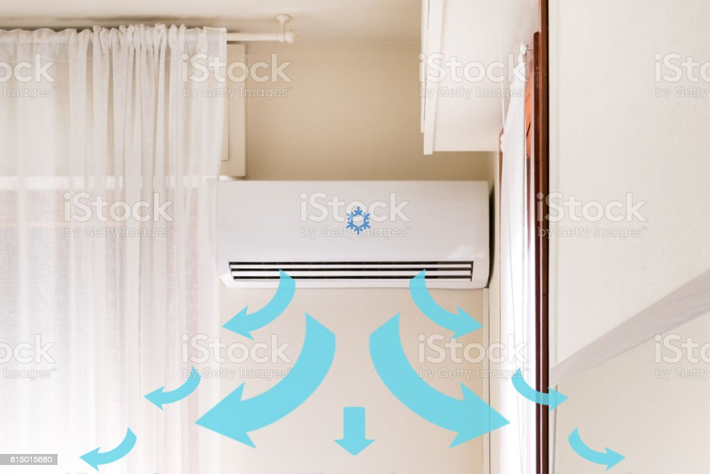 Air conditioner mounted on the room wall for refreshing against summer heat stock photo