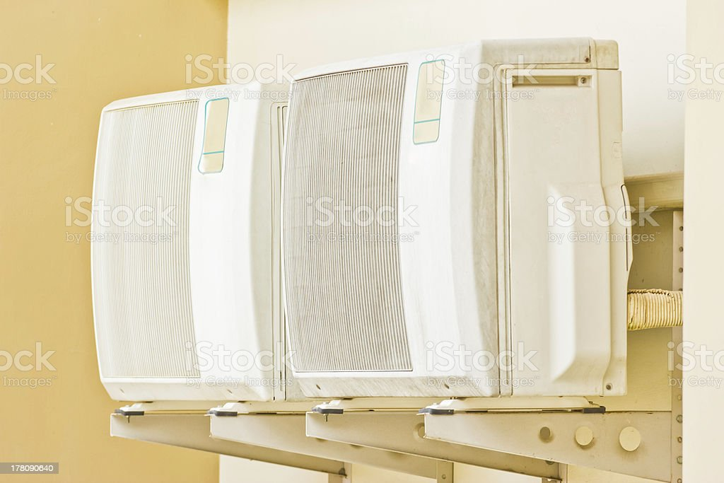 air conditioner on the wall of boards. royalty-free stock photo