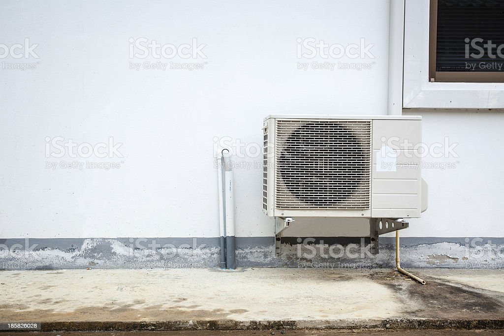 Air conditioner on the wall of boards. stock photo