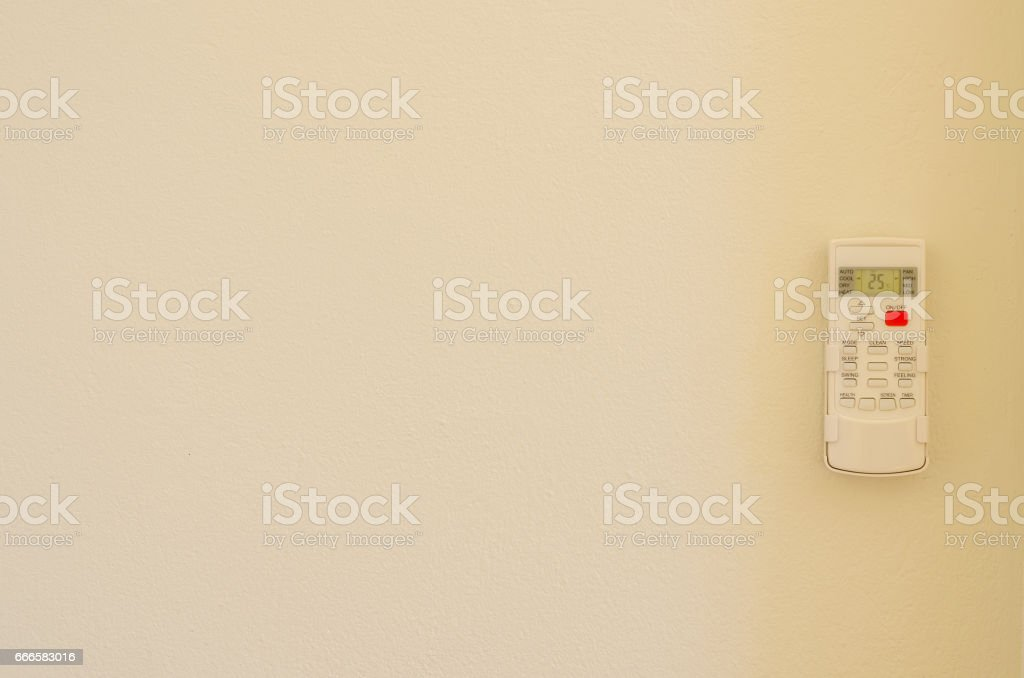 Air conditioner remote control on wall background stock photo