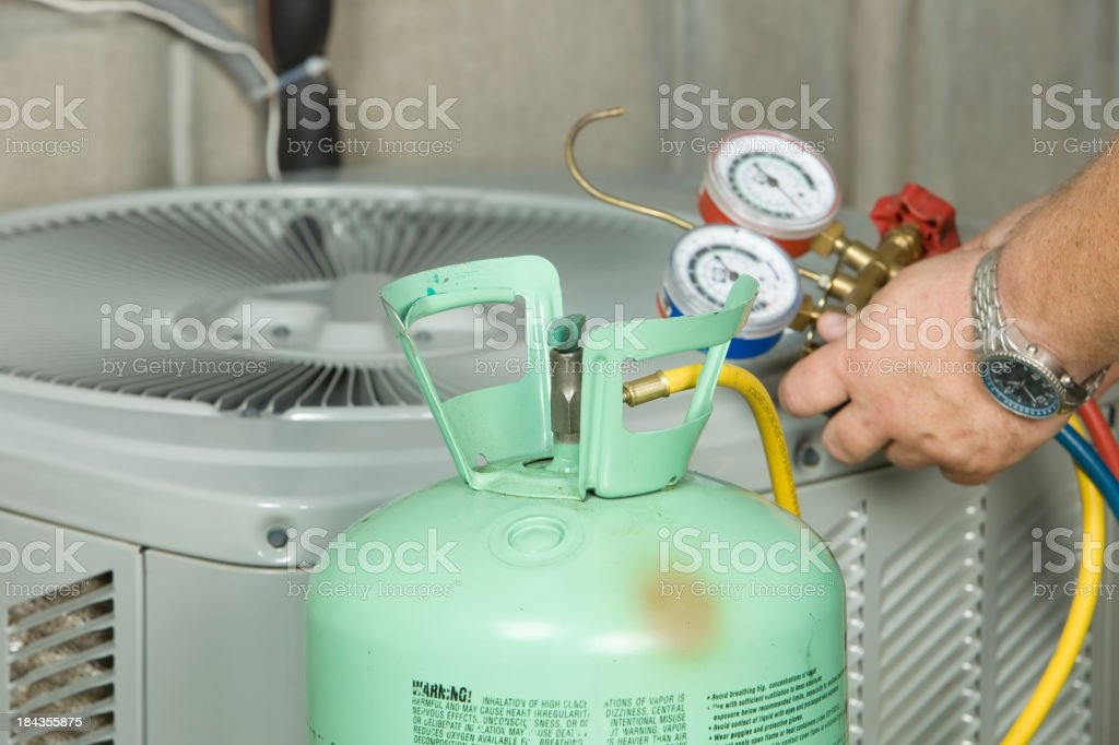 Air Conditioner Repair, Preparing to Charge System stock photo