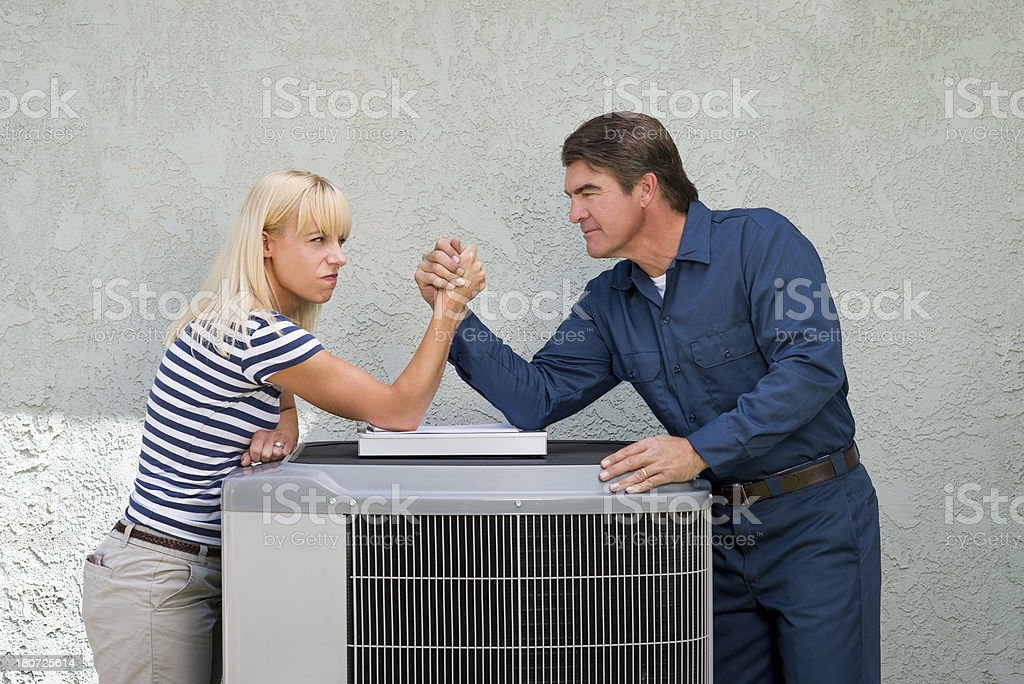 Air Conditioner Repairman And Angry Homeownr stock photo