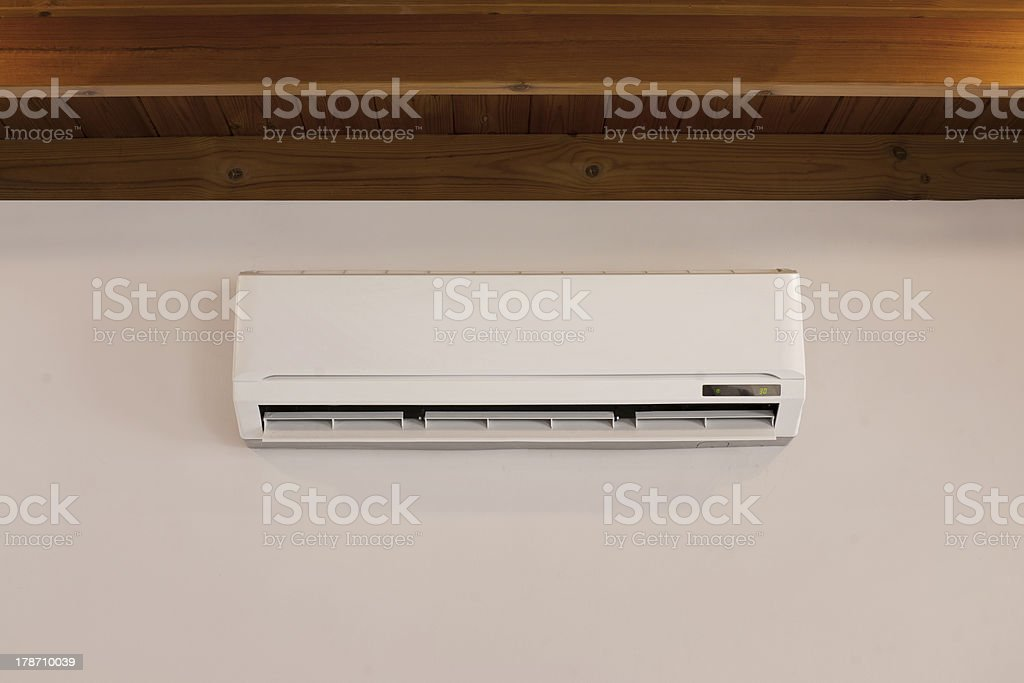 air conditioner unit on a wall royalty-free stock photo