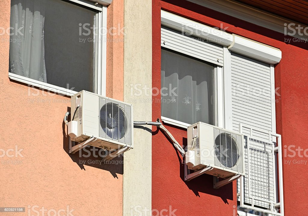 Air conditioners on the wall stock photo