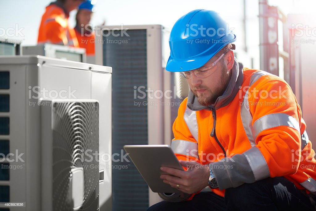 air conditioning maintenance engineer stock photo