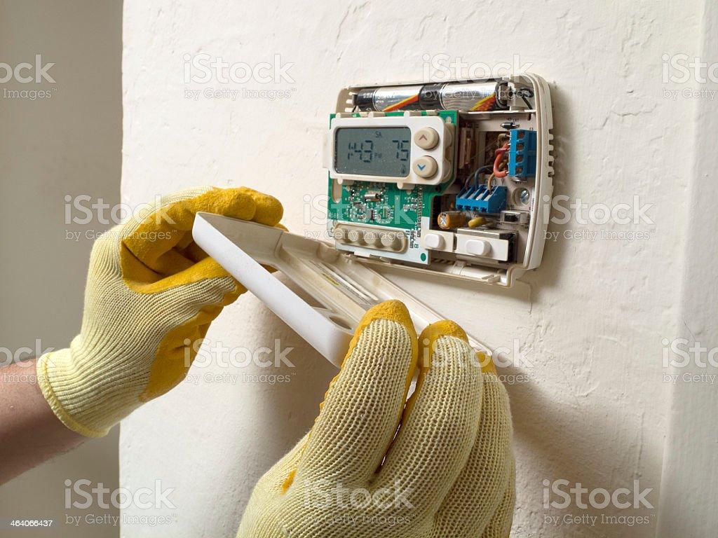 Air conditioning repair man performing maintenance stock photo