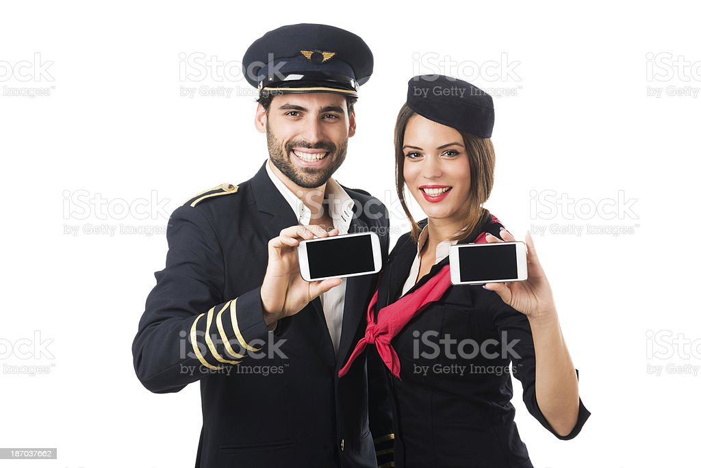 Air crew with mobile devices royalty-free stock photo