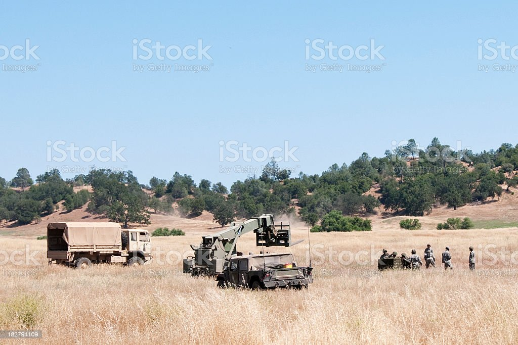 air drop recovery by army soldiers stock photo