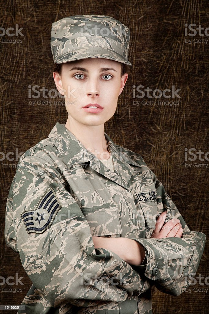 US Air Force Series: American Airwoman against dark brown background stock photo