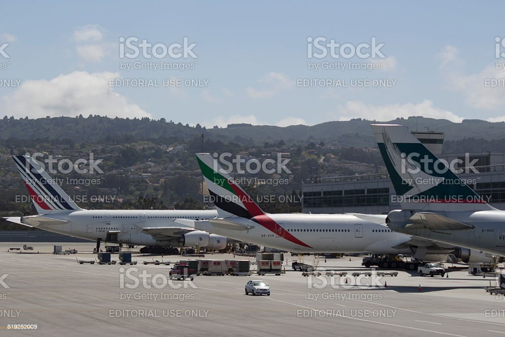 Air France, Emirates, and Cathay Pacific Tail Logos at SFO stock photo
